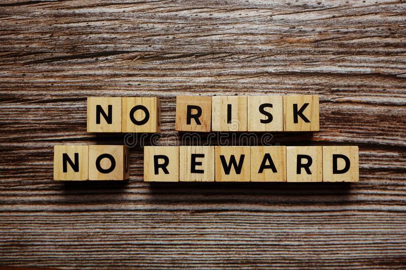 no risk reward alphabet letter wooden background 191484835