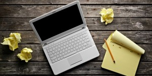 bigstock Laptop with blank notepad and 35817068 300x150
